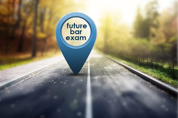 Future Bar Exam in blue map pin standing upright on a roadway